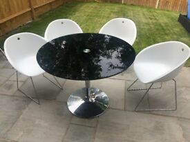 Black round table and chairs for sale