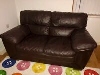 Real leather Brown 2 seater sofa