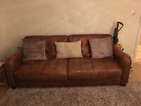 DFS tan leather three seater sofa with matching armchair and storage footstall