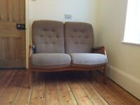 Two seater Cintique sofa in as new condition.