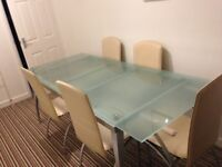Glass Top Expanding Table - 8 seater with 6 chairs
