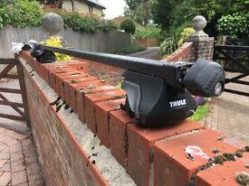 Pair of Thule roof bars. Adjustable, grab grips and key locks.