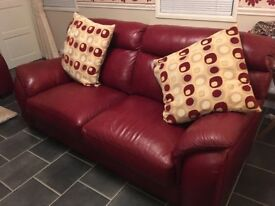 Red leather suite 3 seater and two chairs