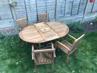Teak garden furniture set including extendable table and 4 stackable chairs