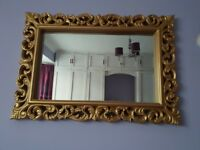 Gold frame Mirror,clock and ornament books