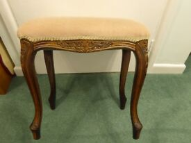 Beige stool with dark elegant curved legs. May be suitable as a piano stool.