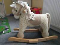 Immaculate condition wooden rocking horse with sounds
