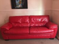 Sofa and arm chair, red leather.