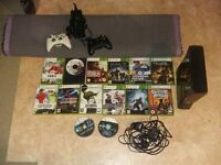 MICROSOFT XBOX 360 S 250 GB GLOSSY BLACK CONSOLE AND GAMES.