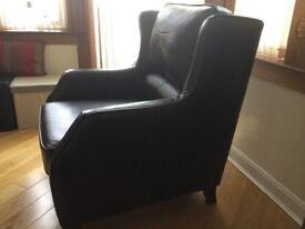Leather effect armchair
