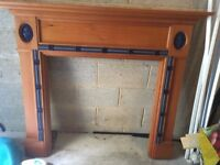 Wood Fire Surround with Blue Ceramic Detail