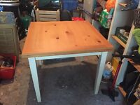 Beautiful wooden extendable table with protective glass top