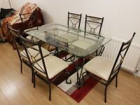 Glass and iron dining table for sale £70