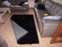 Black long pile floor rug