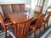 Wooden dining table and 8 chairs