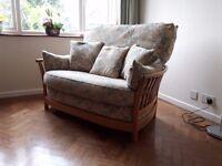 An Ercol small 2 seater sofa.