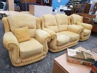 Large light yellow fabric two seater sofa with matching armchairs