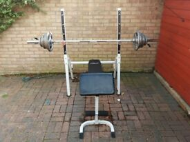 Weight Bench + 7' Olympic Barbell+60kg of Olympic cast iron weight discs