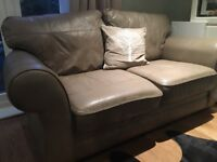 Two large beige leather sofas