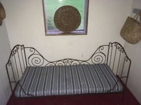Metal day bed with mattress.