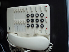 large white telephone with large numbers