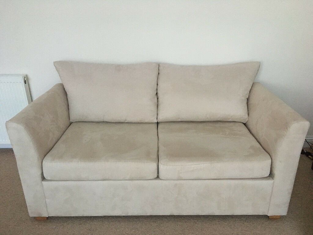 Cream sofa bed with som'toile fold out bed mechanism