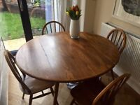 Ercol blonde mid-century drop-leaf dining table and four hoopback chairs