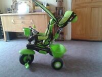 Smart Trike 4 in 1 with phone, bottle holder and sun canopy suitable up to 36 months