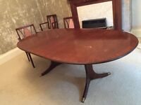 Mahogany extending table with six chairs
