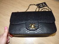 Black Ladies Chanel alligator style. Brand new.