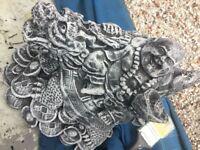 Garden stone ornament of a budda on a foo dragon