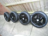 FORD KA ,SET 4,LTD EDITION BLACK ALLOY WHEELS,C/W CENTRES/BADGES/TYRES 165 X 65 X 14 TYRES,STUNNING