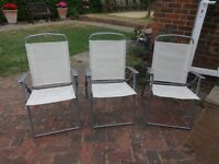 3 clean white fold-up chairs. Very good condition, hardly used. Standard chair size.