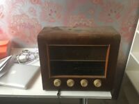 Antique radio in wood casing, Bush label. Low price for someone who loves old radios.