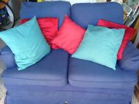 COMFY, BLUE 2-SEATER SOFA, PERFECT FOR SMALLER ROOMS AND WITH AN EXTRA SET OF BUFF-COLOURED COVERS