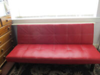 Small sofa bed in red.