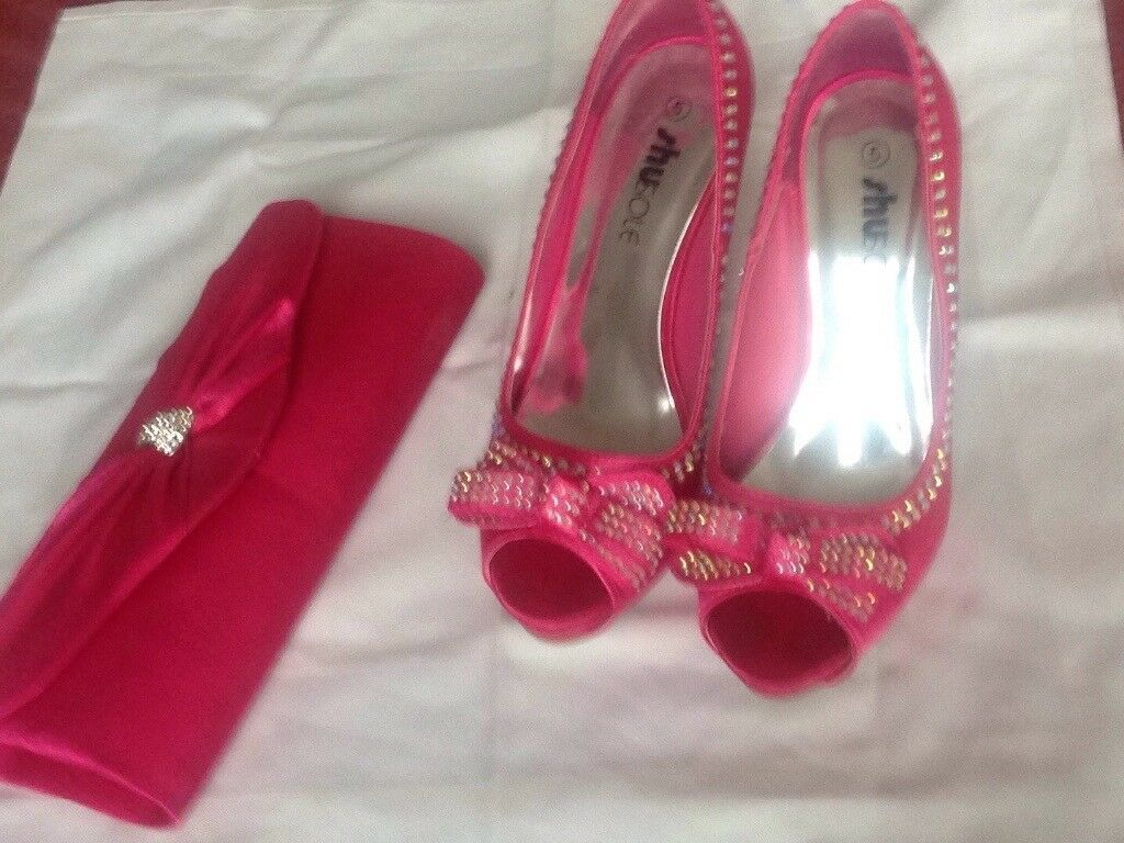 Pink satin shoes and bag