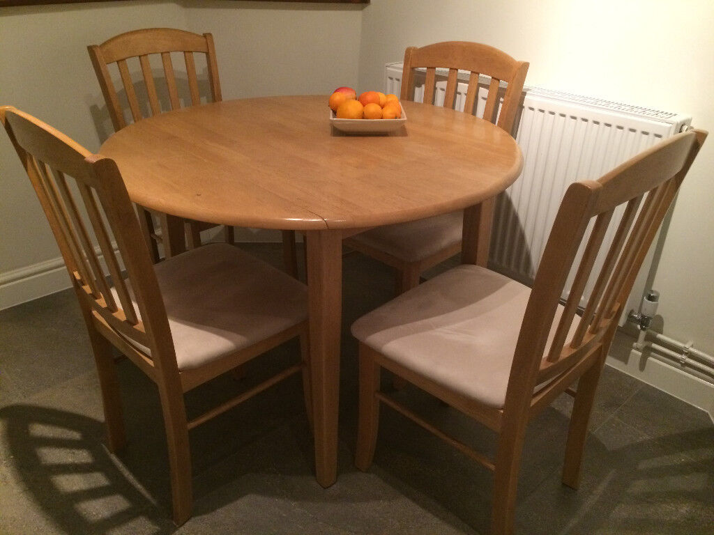 Wooden Dining Table With Optional Fold Down Sides And 4 Chairs