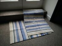 Two rubber backed rugs