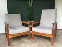 Pair of 1960s Guy Rogers 'Manhattan' teak reclining armchairs