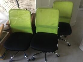 3 green office chairs