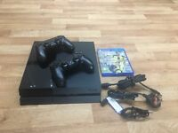PS4 with 2 controllers and Fifa 17. Plus 12 month PlayStation plus