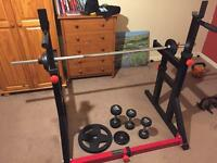 Bodymax squat and dip rack with bar, dumbells, weights.