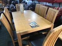 Top quality solid oak dining table and 8 chairs