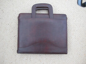 Tula leather work case.