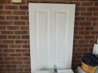 Four white internal doors