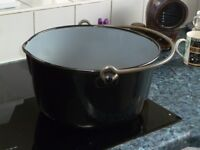 Black jelly pan with blue interior for making jam etc
