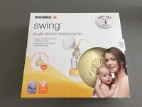Medela Swing Electric Breast Pump (plus bottles)