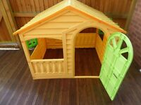 Plastic outdoor playhouse