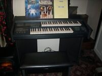 elka concept organ with leather stall and music books